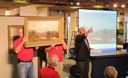 charlie cobb auctioning a painting